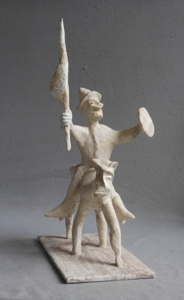 """An Inventive Victory wood, paper, plaster, paint 31""""x 20""""x 16"""""""